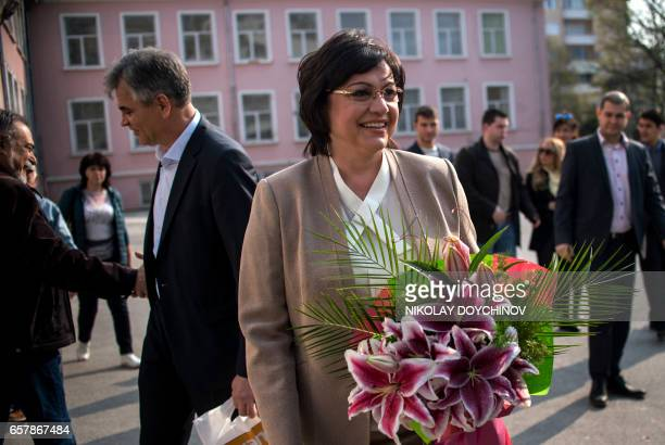 Leader of the Bulgarian Socialist party Kornelia Ninova looks on after casting a vote at a polling station in Sofia on March 26 during the country's...