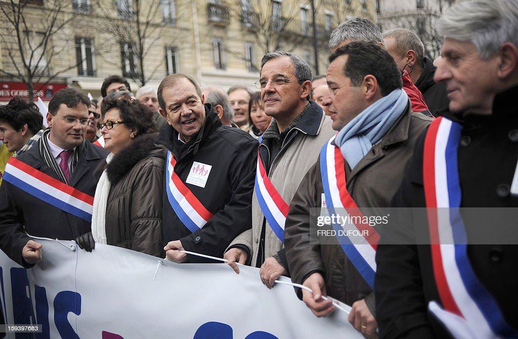 Leader of the Christian Democratic Party (Parti Chrétien-Démocrate), Christine Boutin (2ndL) and French UMP opposition right-wing party members Patrick Ollier (3rdL) and Thierry Mariani (3rdR) take part in a march against same-sex marriage on January 13, 2013 in Paris. Tens of thousands march in Paris on January 13 to denounce government plans to legalise same-sex marriage and adoption which have angered many Catholics and Muslims, France's two main faiths, as well as the right-wing opposition. The French parliament is to debate the bill -- one of the key electoral pledges of Socialist President -- at the end of this month.