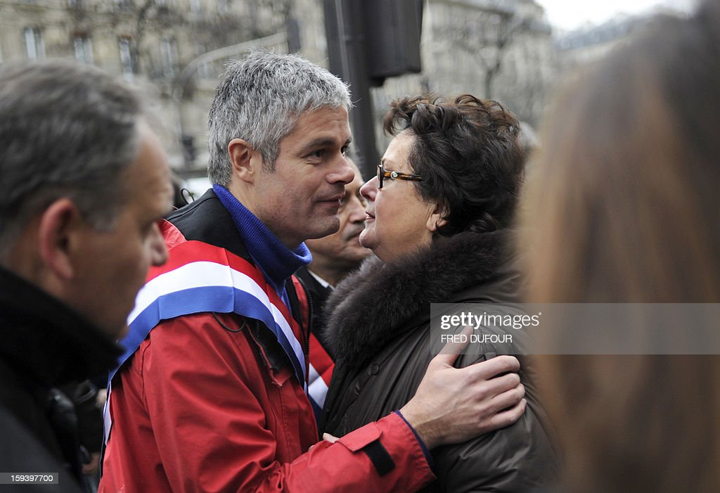 Leader of the Christian Democratic Party (Parti Chrétien-démocrate) Christine Boutin (R) is kissed by French UMP opposition right-wing party member Laurent Wauquiez during a march against same-sex marriage on January 13, 2013 in Paris. Tens of thousands march in Paris on January 13 to denounce government plans to legalise same-sex marriage and adoption which have angered many Catholics and Muslims, France's two main faiths, as well as the right-wing opposition. The French parliament is to debate the bill -- one of the key electoral pledges of Socialist President -- at the end of this month.