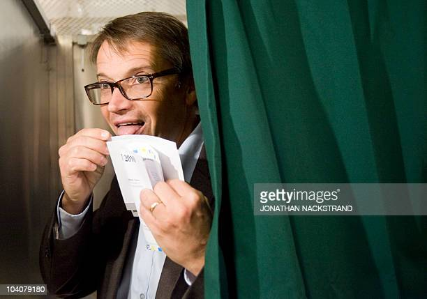 Leader of The Christian Democrats political party and part of the ruling centerright coalition Goran Hagglund licks his voting envelope at an advance...
