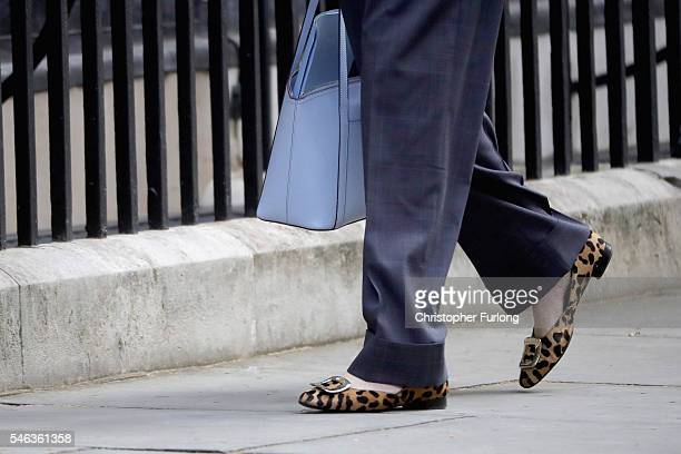 Leader of the Conservative party and Prime Ministerinwaiting Theresa May arrives wearing animal print shoes for David Cameron's last cabinet meeting...