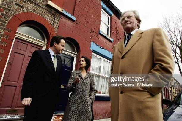 Leader of the Conservative Party David Cameron and Lord Heseltine talk to Nina Edge a resident of the Kelvin Grove area in Liverpool Monday March 6...