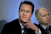Leader of the Conservative Party David Cameron and shadow Foreign Secretary William Hague listen to a speech at the Royal United Services Institute...