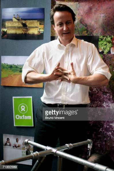 Leader of the Conservative Party David Cameron cracks his knuckles after assembling a water delivery system with frontline Oxfam workers at Oxford...