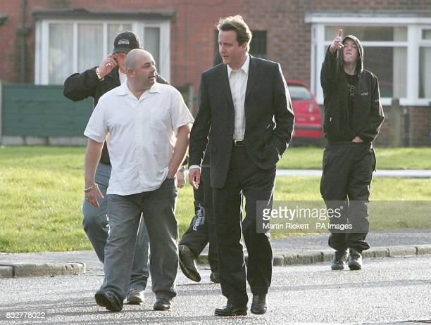 Leader of the Conservative Party David Cameron walks through the Benchill area of Wythenshawe during his visit to Manchester whilst Ryan florence...