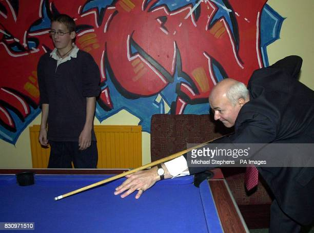 Leader of the Conservative Party Iain Duncan Smith playing pool during a visit to a YMCA Fusion Project in Bournemouth Mr Duncan Smith today insisted...