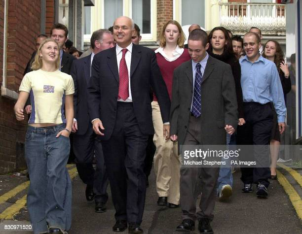 Leader of the Conservative Party Iain Duncan Smith with members of the Fusion Project during his visit to the YMCA in Bournemouth Mr Duncan Smith...
