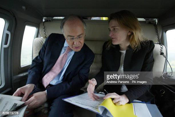 Leader of the Conservatives Michael Howard and his polictical Secretary Rachel Whetstone talk during a flight to Norwich