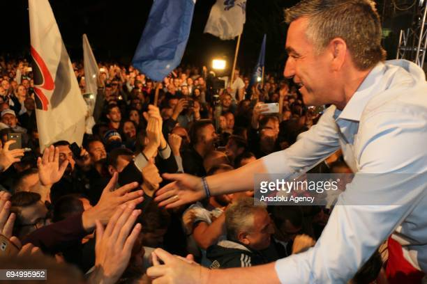 Leader of the Democratic Party of Kosova Kadri Veseli greets the supporters during celebrations of their victory in Pristina Kosovo on June 12 2017...