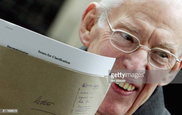 Leader of the Democratic Unionist Party Ian Paisley holds a peace process document after a meeting at Downing Street on November 24 2004 in London...