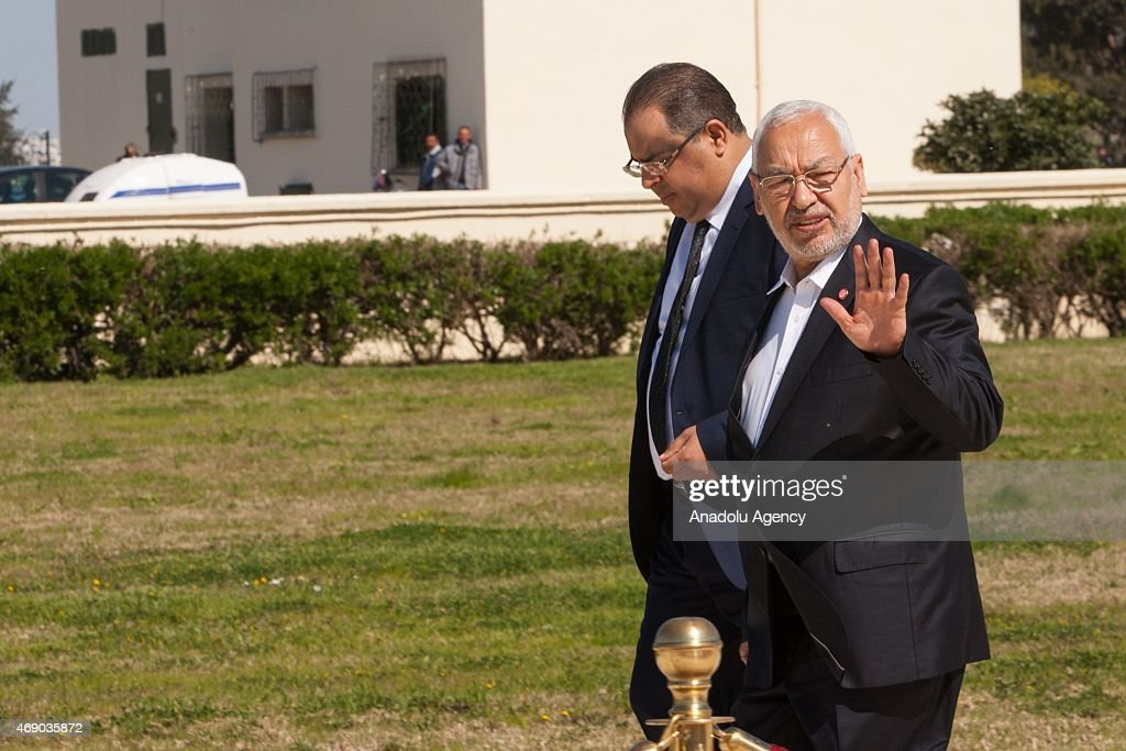 Leader of the Ennahda movement Rashid al-Ghannushi (R) attends the 77th anniversary of Martyrs' Day commemoration at the Sijoumi martyrs' mausoleum on April 9, 2015 in Tunis, Tunisia. Martyrs' Day is observed by Tunisians to salute the martyrdom of soldiers who lost their lives defending the sovereignty of the nation.