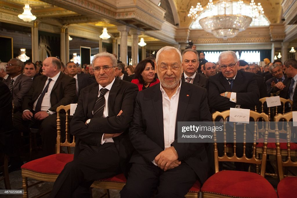 Leader of the Ennahda movement Rashid al-Ghannushi (R) is seen at the Carthage Palace during the Independence Day celebrations marking the 58th anniversary of the independence in Tunis, Tunisia on March 20, 2015.