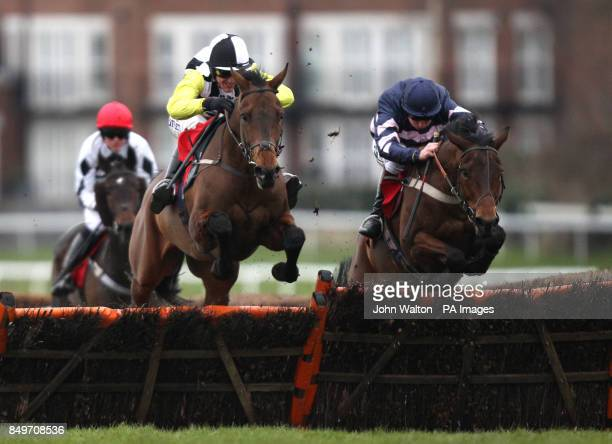 Leader of the gang ridden by Tony McCoy jumps the last on the way to being beaten into second place by Be All Man ridden by Jamie Moore in The David...