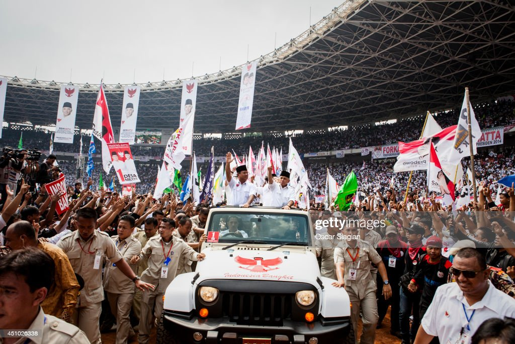 Leader of the Gerindra Party, Presidential candidate retired general <a gi-track='captionPersonalityLinkClicked' href=/galleries/search?phrase=Prabowo+Subianto&family=editorial&specificpeople=3051840 ng-click='$event.stopPropagation()'>Prabowo Subianto</a> and vice-presidential candidate Hatta Rajasa greets to supporters during an election rally at Gelora Bung Karno stadium on June 22, 2014 in Jakarta, Indonesia. A leaked military dismissal letter this week is again raising questions about Prabowo's involvement in human rights violations in 1998 when he was the head of Indonesia's special forces. It has not been confimed that the letter is authentic. Indonesians will elect a new president on July 9, 2014.