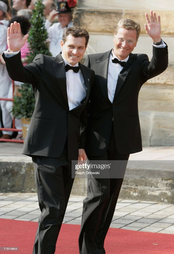 Leader of the German Liberal party (FDP) Guido Westerwelle (R) and his partner Michael Mronz arrive for the opening performance of Richard Wagner's 'Der fliegende Hollaender', on the first day of the 95th Richard Wagner Festival July 25, 2006 in Bayreuth, Germany. The festival runs until August 28, 2006.