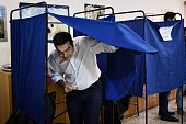 Leader of the Greek radicalleft Syriza party and former Prime Minister Alexis Tsipras exits a polling booth prior to cast his vote at a polling...