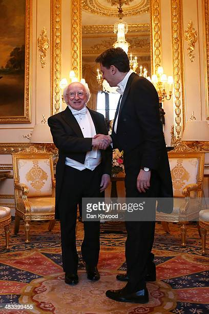 Leader of the Labour Party Ed Miliband greets the President of Ireland Michael D Higgins ahead of a State Banquet on April 8 2014 in Windsor England...