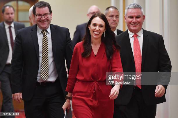 Leader of the Labour party Jacinda Ardern arrives at a press conference with MPs Kelvin Davis and Grant Robertson at Parliament in Wellington on...