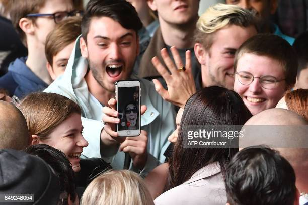 Leader of the Labour Party Jacinda Ardern is mobbed by university students during a visit to Victoria University in Wellington on September 19 2017...