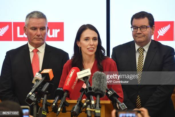 Leader of the Labour Party Jacinda Ardern speaks at a press conference with MPs Kelvin Davis and Grant Robertson at Parliament in Wellington on...