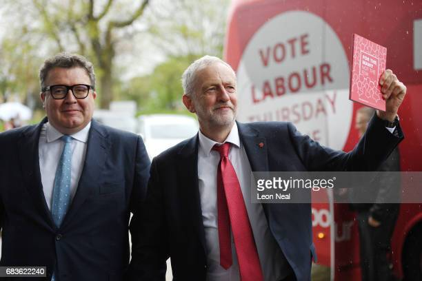 Leader of the Labour Party Jeremy Corbyn holds a copy of the manifesto as he arrives with Deputy Leader Tom Watson prior to the launch of the Labour...