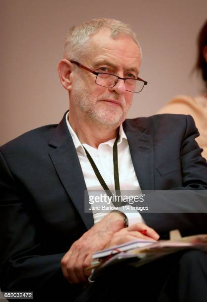Leader of the Labour Party Jeremy Corbyn listens as Shadow Chancellor John McDonnell speaks at the Labour Economic Conference in Glasgow