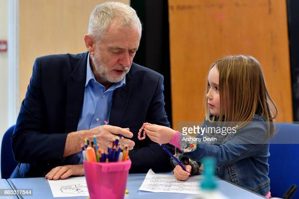 Leader of the Labour Party Jeremy Corbyn MP is given a loom band by Zofia BylinskiGelded during a visit to a children's holiday club in Leyand where...