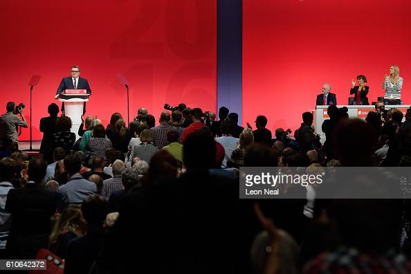 Leader of the Labour Party Jeremy Corbyn remains seated during a standing ovation for Deputy leader of the Labour party Tom Watson during his keynote...