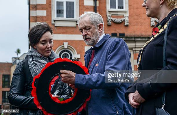 Leader of the Labour Party Jeremy Corbyn shows his wreath to a member of the public at Royal Northern Gardens in Islington on November 8 2015 in...