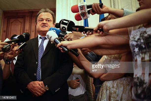 Leader of the Liberal Democrat Party and former Senate speaker Vasile Blaga talk to the media in Bucharest on July 3 shortly before being sacked by...