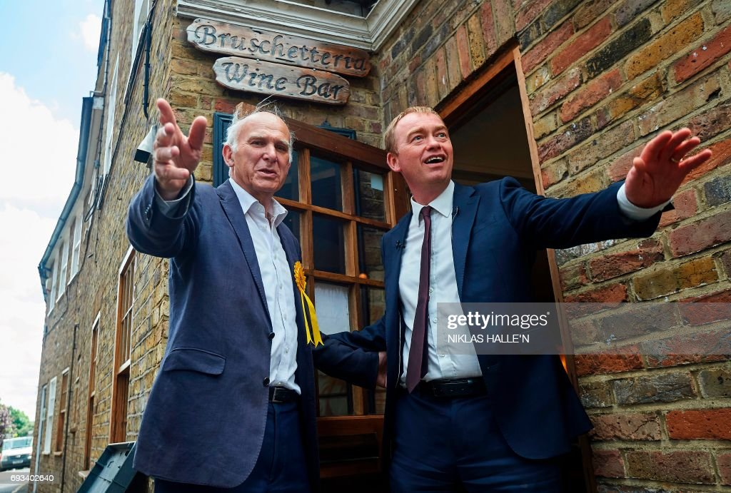 Leader of the Liberal Democrats, Tim Farron (R) and attends a campaign visit with the party's candidate for the Twickenham constituency, Vince Cable, in Twickenham, south-west London on June 7, 2017, on the eve of the general election. Britain on Wednesday headed into the final day of campaigning for a general election darkened and dominated by jihadist attacks in two cities, leaving forecasters struggling to predict an outcome on polling day. / AFP PHOTO / NIKLAS HALLE'N