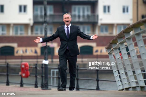 Leader of the Liberal Democrats Tim Farron gestures when walking while in Cardiff Bay to formally launch the Welsh Liberal Democrat general election...