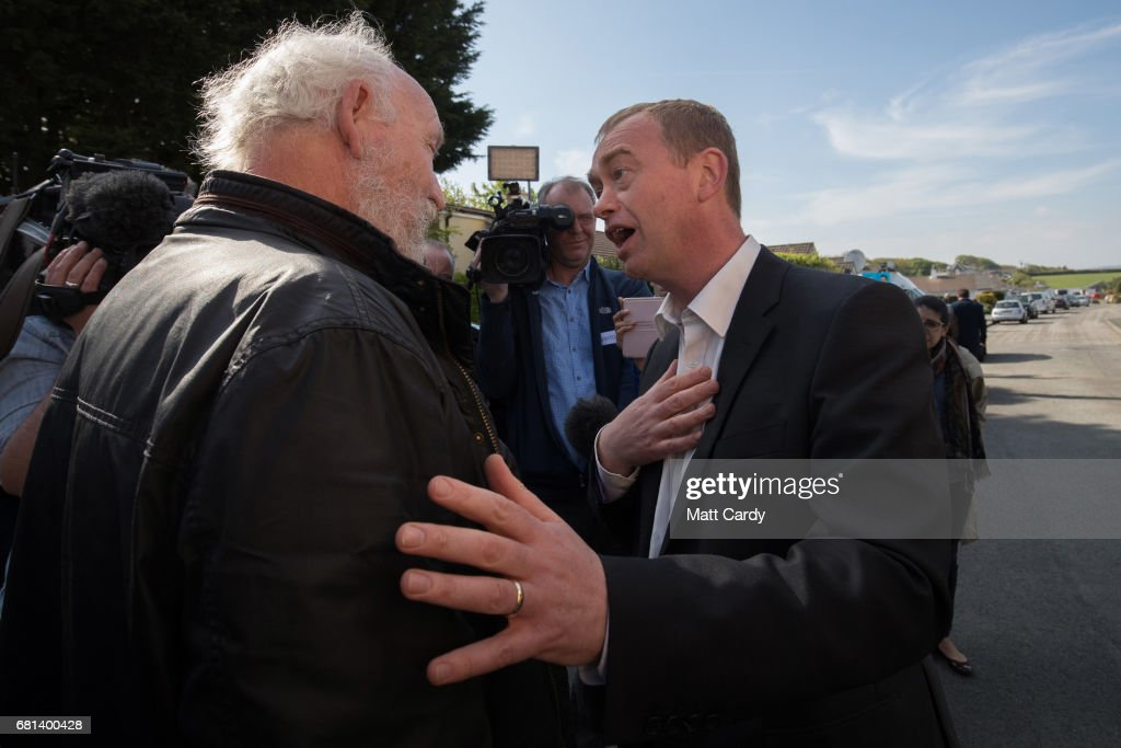 Leader of the Liberal Democrats Tim Farron speaks with pro-Brexit supporter Alan Haithwaite as he visits Lewannick Primary School near Launceston on May 10, 2017 in Cornwall, England. The Liberal Democrat leader's visit to the school in the North Cornwall parliamentary constituency was used to unveil the party's education funding policy as part of their general election manifesto.