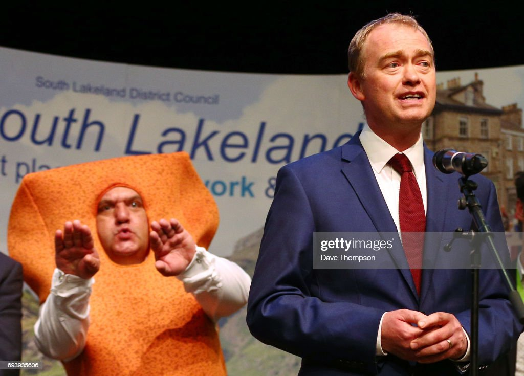 Leader of the Liberal democrats Tim Farron stands in front of Independent candidate Mr Fishfinger following the announcement of the results and that he would keep his seat at the Westmoorland and Lonsdale constituency count at Kendal Leisure Centre on June 9, 2017 in Kendal, United Kingdom. After a snap election was called, the United Kingdom went to the polls yesterday following a closely fought election. The results from across the country are being counted and an overall result is expected in the early hours.