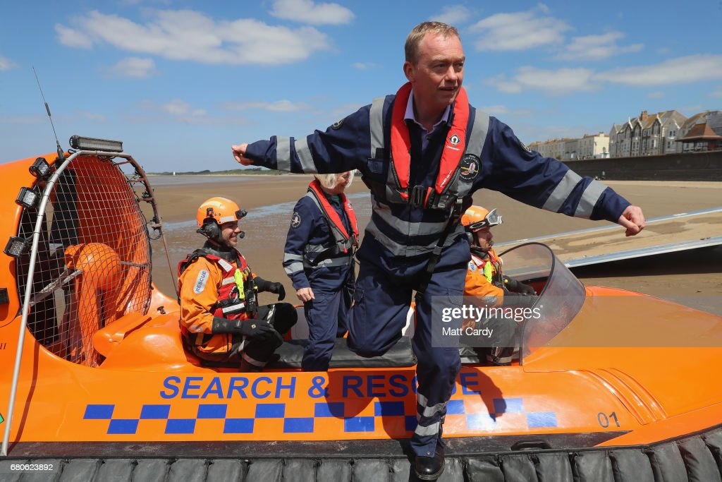 Leader of the Liberal Democrats Tim Farron steps off a search and rescue boat as he campaigns at a volunteer-run Rescue Boat Service on May 9, 2017 at Burnham-on-Sea, England. Campaigning is underway ahead of the June 8th general election.