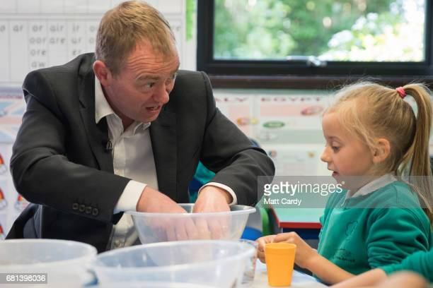 Leader of the Liberal Democrats Tim Farron takes part in a cookery lesson in a classroom as he visits Lewannick Primary School near Launceston on May...