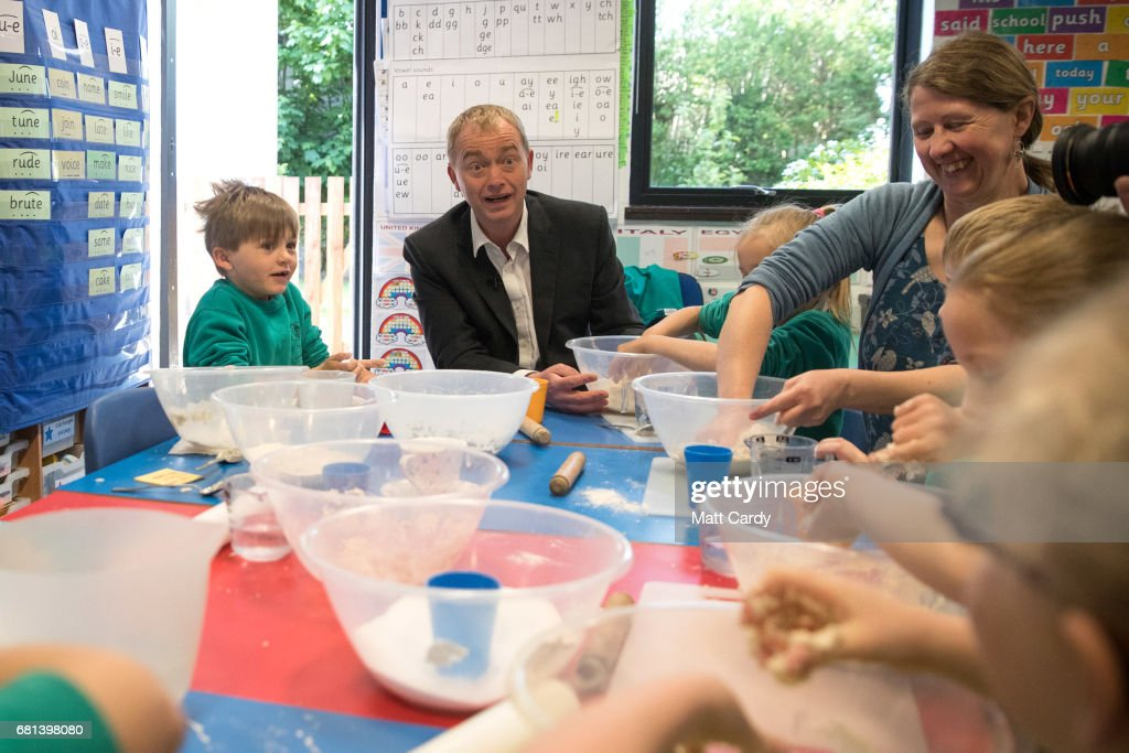 Leader of the Liberal Democrats Tim Farron takes part in a cookery lesson in a classroom as he visits Lewannick Primary School near Launceston on May 10, 2017 in Cornwall, England. The Liberal Democrat leader's visit to the school in the North Cornwall parliamentary constituency was used to unveil the party's education funding policy as part of their general election manifesto.