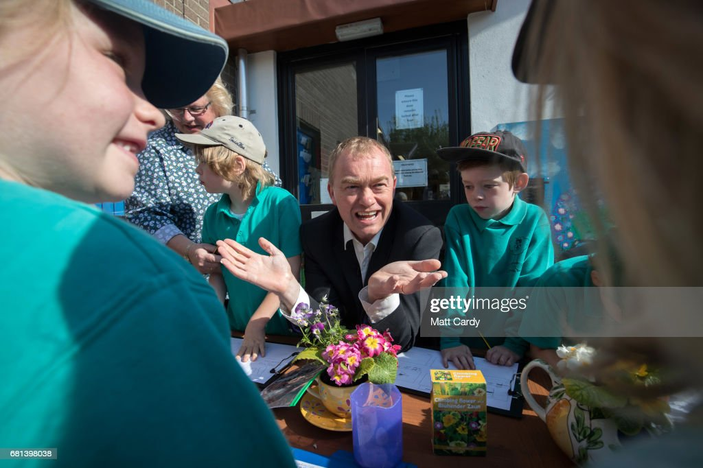 Leader of the Liberal Democrats Tim Farron takes part in a gardening lesson as he visits Lewannick Primary School near Launceston on May 10, 2017 in Cornwall, England. The Liberal Democrat leader's visit to the school in the North Cornwall parliamentary constituency was used to unveil the party's education funding policy as part of their general election manifesto.