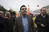 Leader of the main opposition party leftist Alexis Tsipras is seen when thousands of Greeks march in central Athens during a protest rally against a...