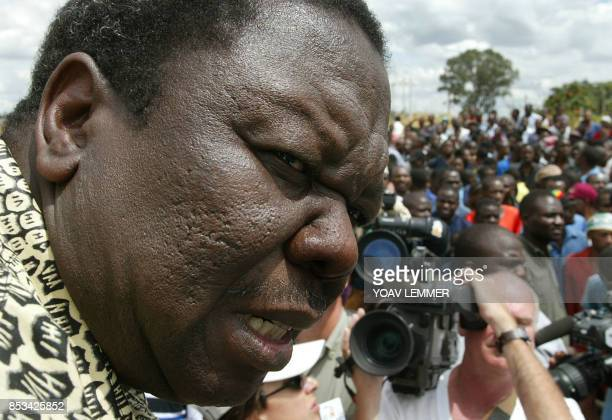 Leader of the Movement for Democratic Change Morgan Tsvangirai speaks to supporters during an election gathering in Harare 08 March 2002 Zimbabweans...