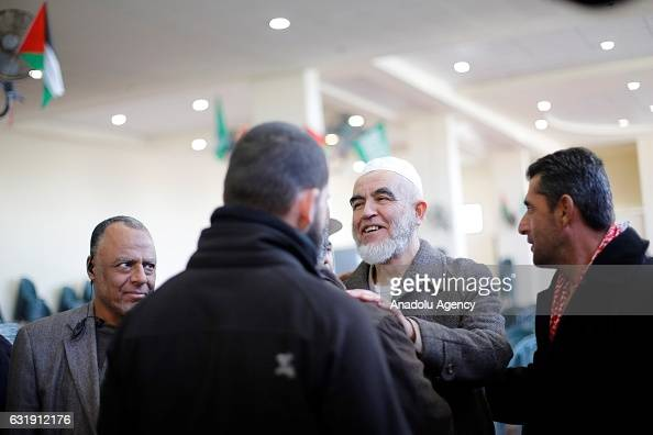 Leader of the Northern Branch of the Islamic Movement in Israel Sheikh Raed Salah talks with people during his welcoming ceremony after he was...
