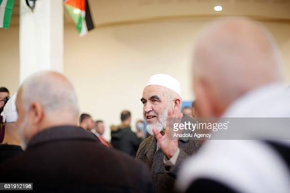 Leader of the Northern Branch of the Islamic Movement in Israel Sheikh Raed Salah greets people during his welcoming ceremony after he was released...
