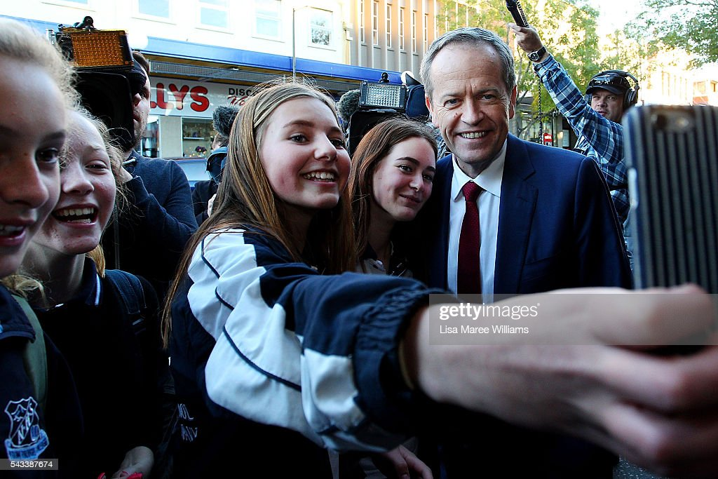 Leader of the Opposition, <a gi-track='captionPersonalityLinkClicked' href=/galleries/search?phrase=Bill+Shorten&family=editorial&specificpeople=606712 ng-click='$event.stopPropagation()'>Bill Shorten</a> takes a photo with local girls during a street walk on June 28, 2016 in Nowra, Australia.The latest Newspoll shows the Coalition has pulled ahead of the Labor Party, less than a week out from the July 2 election. On a two-party preferred basis, the Coalition now leads Labor 51-49, breaking the deadlock from the last poll.