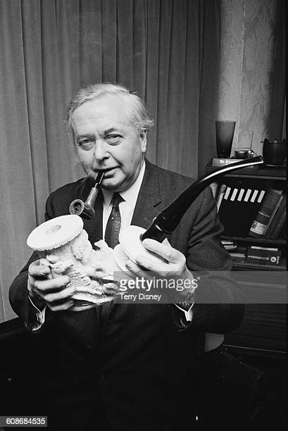 Leader of the Opposition Harold Wilson inspects a large 100yearold Meerschaum pipe at the 'Smoking Through the Ages' exhibition Park Lane London...