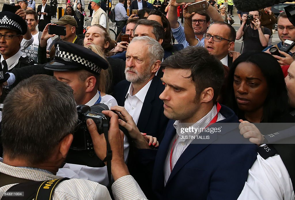 Leader of the opposition Labour Party Jeremy Corbyn (C) arrives to deliver a speech outside parliament during a pro-Corbyn demonstration in central London on June 27, 2016. Britain's historic decision to leave the 28-nation bloc has sent shockwaves through the political and economic fabric of the nation. It has also fuelled fears of a break-up of the United Kingdom with Scotland eyeing a new independence poll, and created turmoil in the opposition Labour party where leader Jeremy Corbyn is battling an all-out revolt. TALLIS