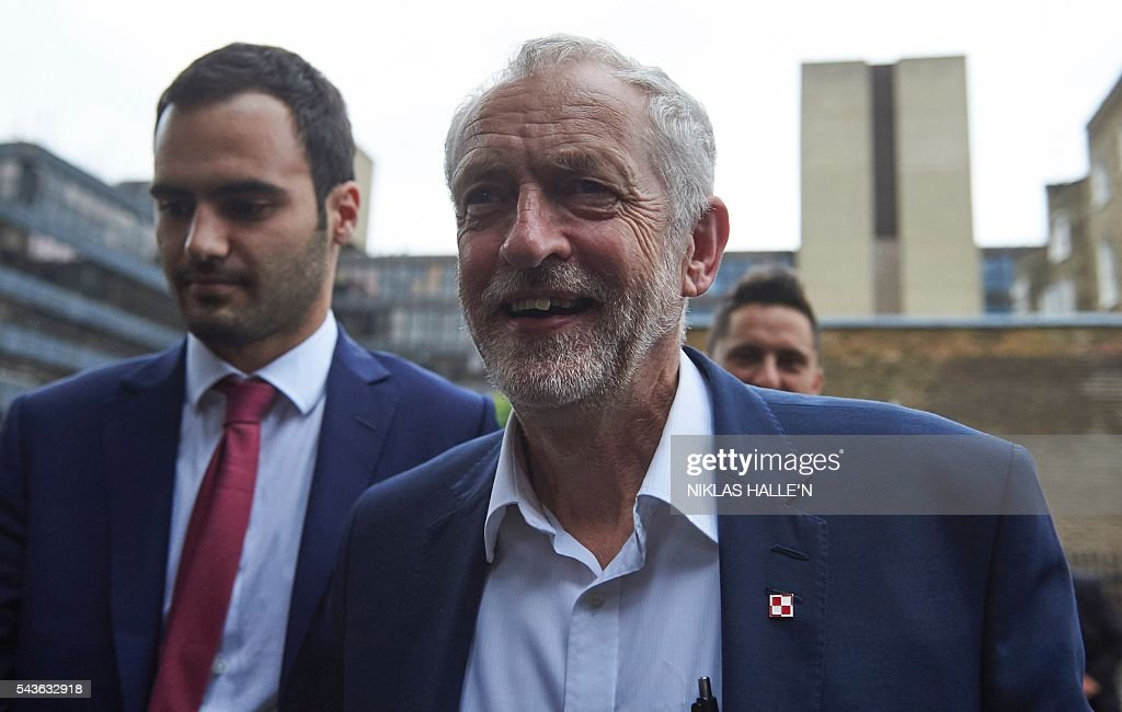 Leader of the opposition Labour Party, Jeremy Corbyn (C) arrives to deliver a speech to supporters at the School of Oriental and African Studies (SOAS) in central London on June 29, 2016. Corbyn has vowed to stay in his job despite losing a confidence vote of MPs in his Labour party, dozens of whom have quit his frontbench team in recent days. Even Corbyn's deputy Tom Watson has said he should quit, predicting there would be a formal leadership contest. N