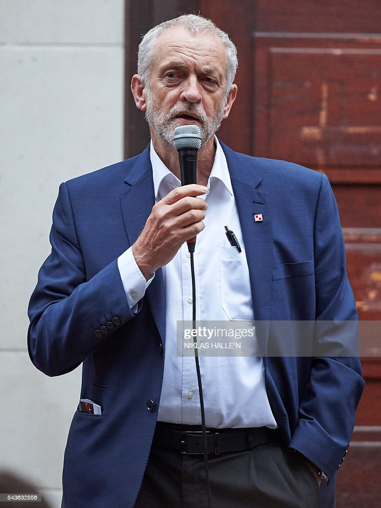 Leader of the opposition Labour Party, Jeremy Corbyn delivers a speech to supporters at the School of Oriental and African Studies (SOAS) in central London on June 29, 2016. Corbyn has vowed to stay in his job despite losing a confidence vote of MPs in his Labour party, dozens of whom have quit his frontbench team in recent days. Even Corbyn's deputy Tom Watson has said he should quit, predicting there would be a formal leadership contest. N