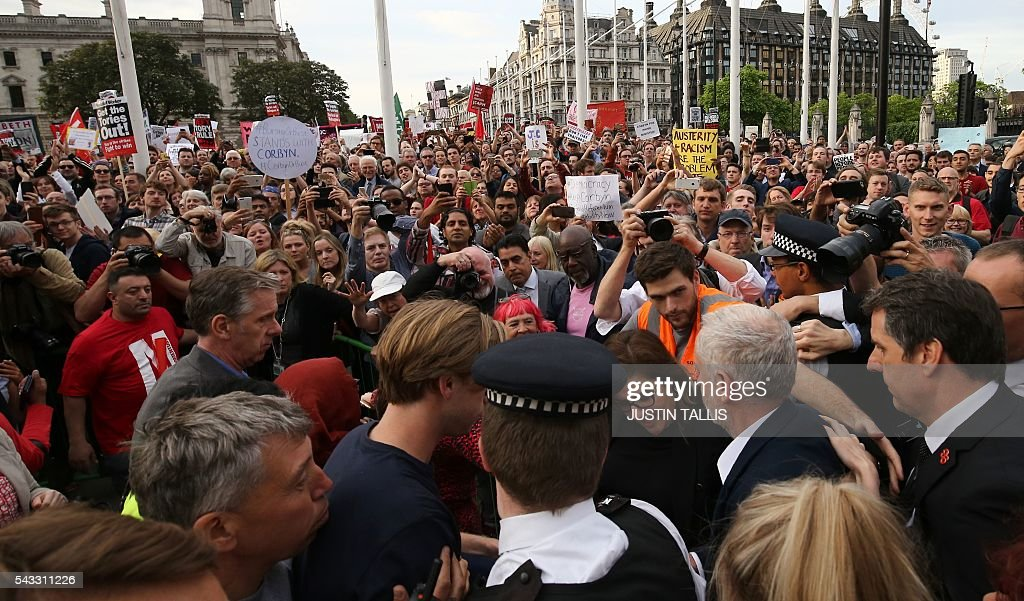 Leader of the opposition Labour Party Jeremy Corbyn (below right) is surrounded by supporters as he arrives to deliver a speech outside parliament during a pro-Corbyn demonstration in central London on June 27, 2016. Britain's historic decision to leave the 28-nation bloc has sent shockwaves through the political and economic fabric of the nation. It has also fuelled fears of a break-up of the United Kingdom with Scotland eyeing a new independence poll, and created turmoil in the opposition Labour party where leader Jeremy Corbyn is battling an all-out revolt. TALLIS