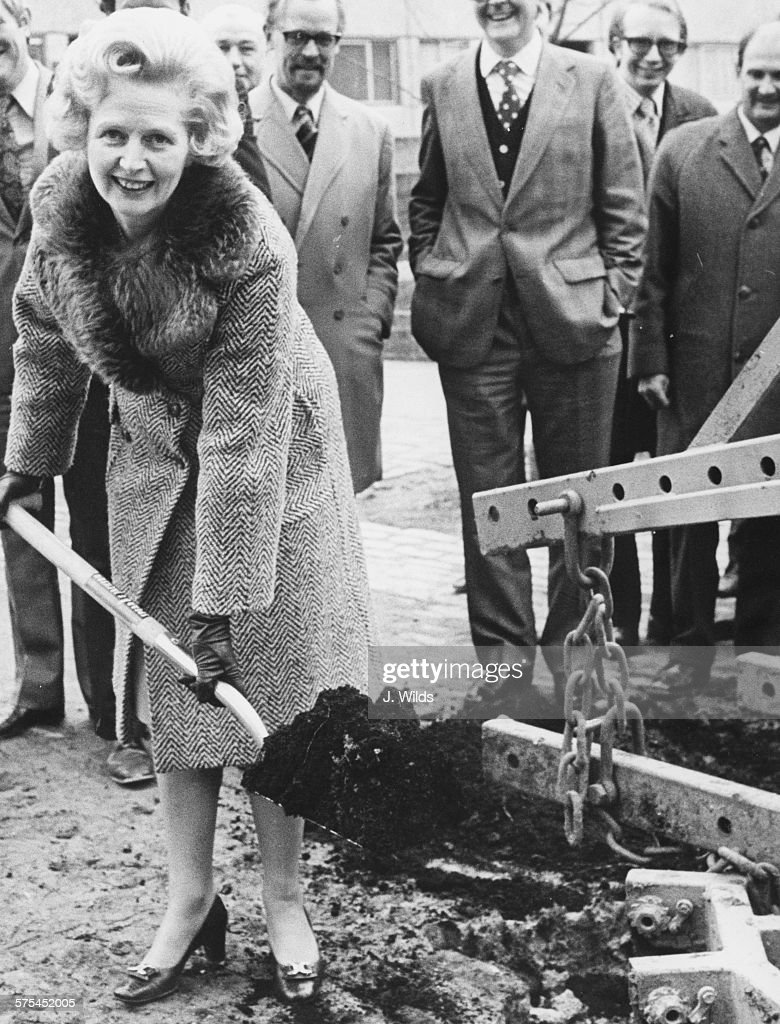 Leader of the Opposition Margaret Thatcher digging a hole as she helps to plant a linden tree to mark National Tree Week at the Lisson Green Estate in Marylebone, London, March 14th 1975.