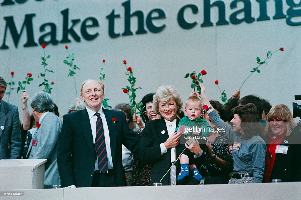 Leader of the Opposition <a gi-track='captionPersonalityLinkClicked' href=/galleries/search?phrase=Neil+Kinnock&family=editorial&specificpeople=178980 ng-click='$event.stopPropagation()'>Neil Kinnock</a> with his wife Glenys Kinnock at the Labour Party Conference in Brighton, October 1989. The 1989 Labour Party slogan is partly visible behind them - 'Meet the Challenge, Make the Change'.